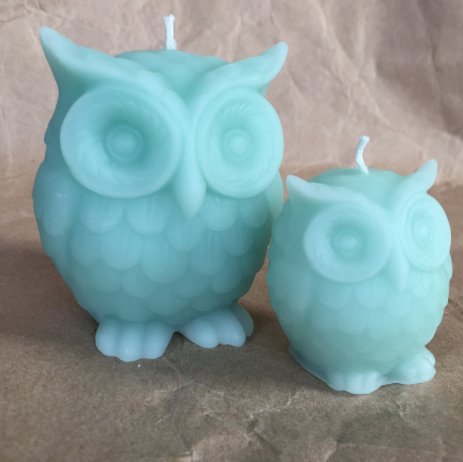 Large and small wise owl candles in sea glass (other colors available).