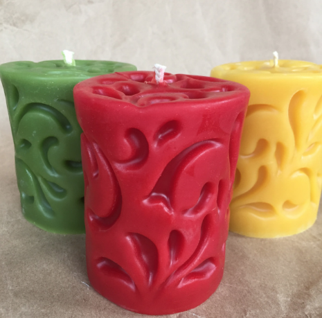 """Pillar candles (3 x 5"""") with carved scrolls in green, red and natural beeswax (other colors available)."""