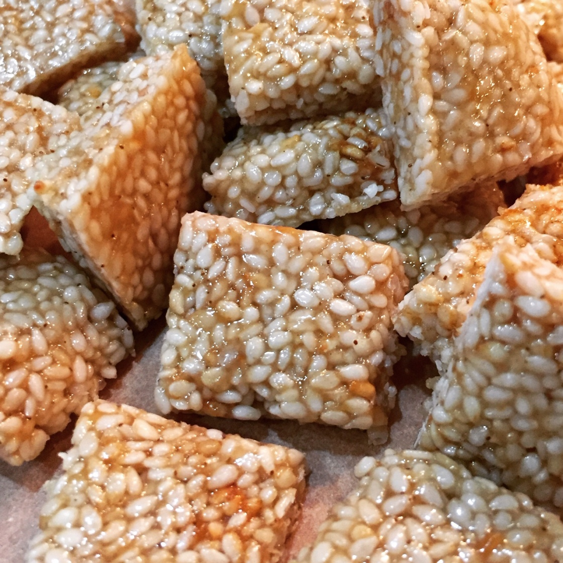 Macro image showing the honeycomb like structure of this light, aromatic crunchy candy topped with flakey sea salt..